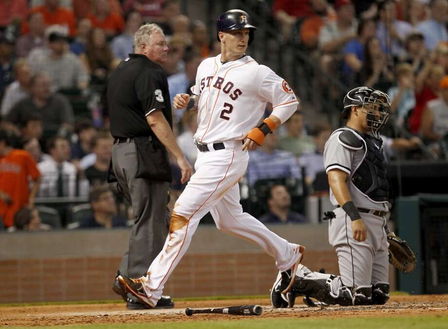 Brandon Barnes of the Astros scores a run against the White Sox.