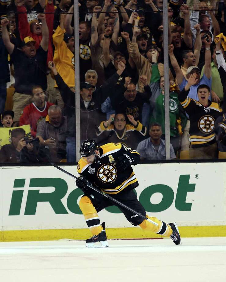 BOSTON, MA - JUNE 17:  Patrice Bergeron #37 of the Boston Bruins celebrates after scoring a goal in the second period against the Chicago Blackhawks in Game Three of the 2013 NHL Stanley Cup Final at TD Garden on June 17, 2013 in Boston, Massachusetts.  (Photo by Bruce Bennett/Getty Images) Photo: Bruce Bennett