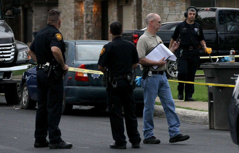 San Antonio police said when a man emerged from a duplex in the 5200 block of Gawain holding a shotgun, they shot him in the torso and he died on the front porch. Photo: John Davenport / San Antonio Express-News