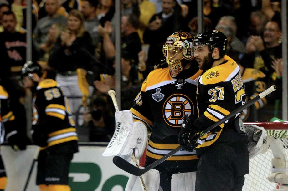 Boston's Patrice Bergeron congratulates goaltender Tuukka Rask after the Bruins shut out the Chicago Blackhawks 2-0 in Game 3 of the Stanley Cup Finals on Monday night at TD Garden. Photo: Harry How / Getty Images