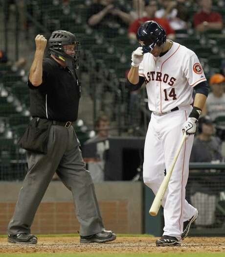 Home plate umpire Tim Welke calls Astros left fielder J.D. Martinez out on strikes. He left two men on base in the seventh. Photo: Thomas B. Shea /For The Houston Chronicle