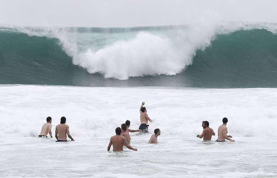 Italy players relax in the breakers of the Atlantic ocean at the soccer Confederations Cup in Rio de Janeiro, Brazil, Monday, June 17, 2013. (AP Photo/Antonio Calanni) Photo: Antonio Calanni, Associated Press