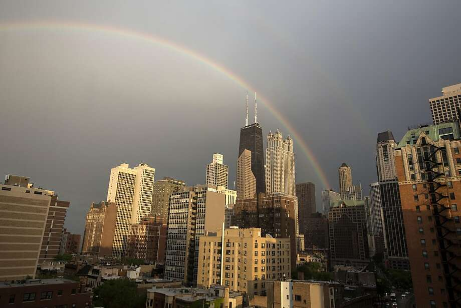 A rainbow appears over Chicago after a quick rain shower, Monday, June 17, 2013. (AP Photo/Scott Eisen) Photo: Scott Eisen, Associated Press