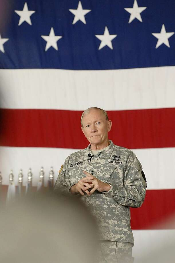 "Army Gen. Martin Dempsey, the chairman of the Joint Chiefs of Staff, visits with Airmen at Minot airforce base in Minot, N.D., on Monday, June 17, 2013. Dempsey made the trip just days after the commander in charge of training and proficiency at the base's 91st Missile Wing was ousted due to ""a loss of confidence."" (AP Photo/Will Kincaid) Photo: Will Kincaid, Associated Press"
