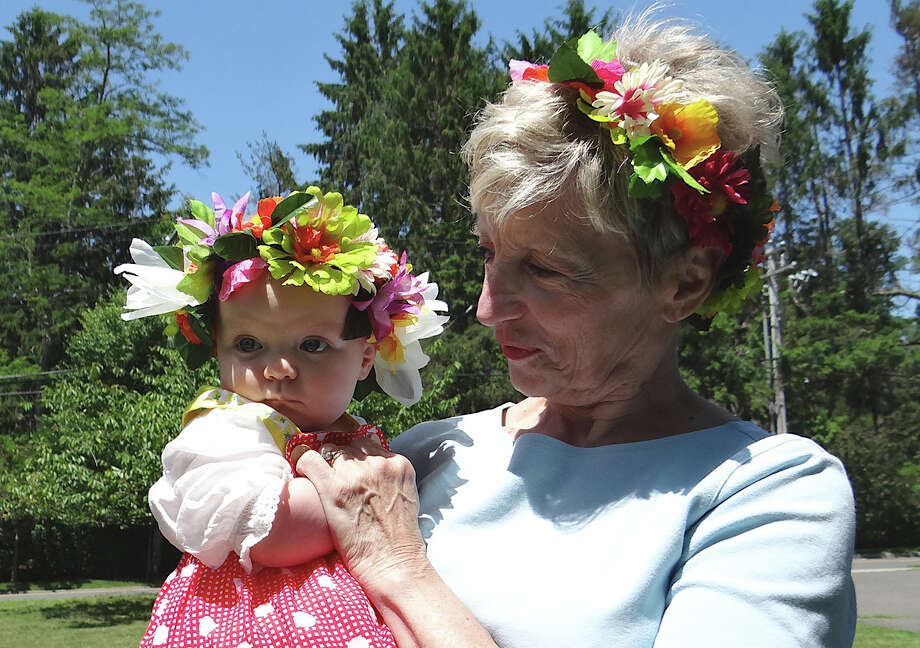 Kay Montgomery, of Rockford, Ill.,, and her granddaughter, Lulu Colman, of Holmes, N.Y., with traditional flowers in their hair for the Midsummer Festival on Saturday at the Scandinavian Club. Photo: Mike Lauterborn / Fairfield Citizen
