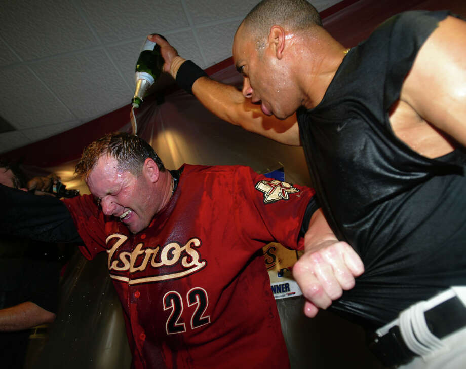 Roger Clemens is doused with champagne by Jose Vizcaino in the clubhouse after the Astros' win 7-6 victory in the 18th inning of Game 4 of the National League Division Series between the Astros and the Atlanta Braves,. Photo: Karen Warren, HOUSTON CHRONICLE / HOUSTON CHRONICLE