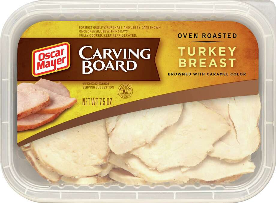 In this undated photo provided by Kraft Foods Inc., a package of Oscar Mayer Carving Board Turkey Breast is shown. More companies are now trying to make processed foods appear more homespun. Photo: Kraft Foods Inc.