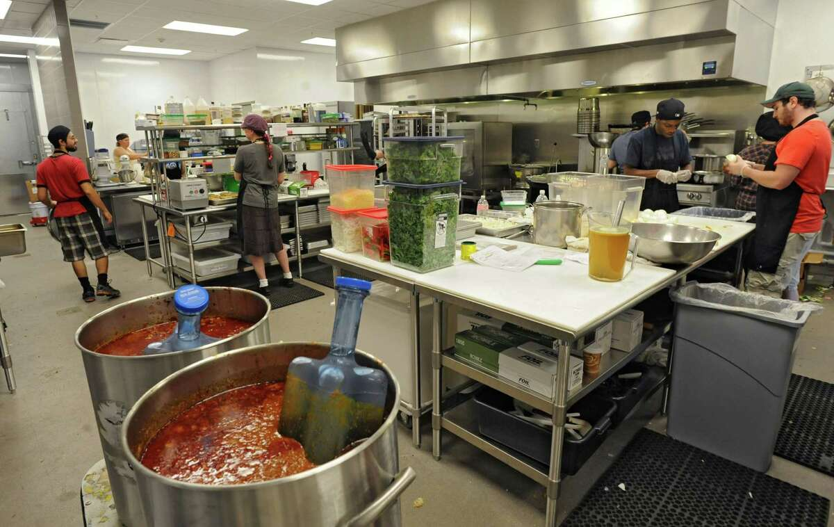 Workers are busy making recipes in the kitchen at the new Honest Weight Food Co-op at 100 Watervliet Ave. on Monday, June 17, 2013 in Albany, N.Y. The soft opening is Wednesday. (Lori Van Buren / Times Union)