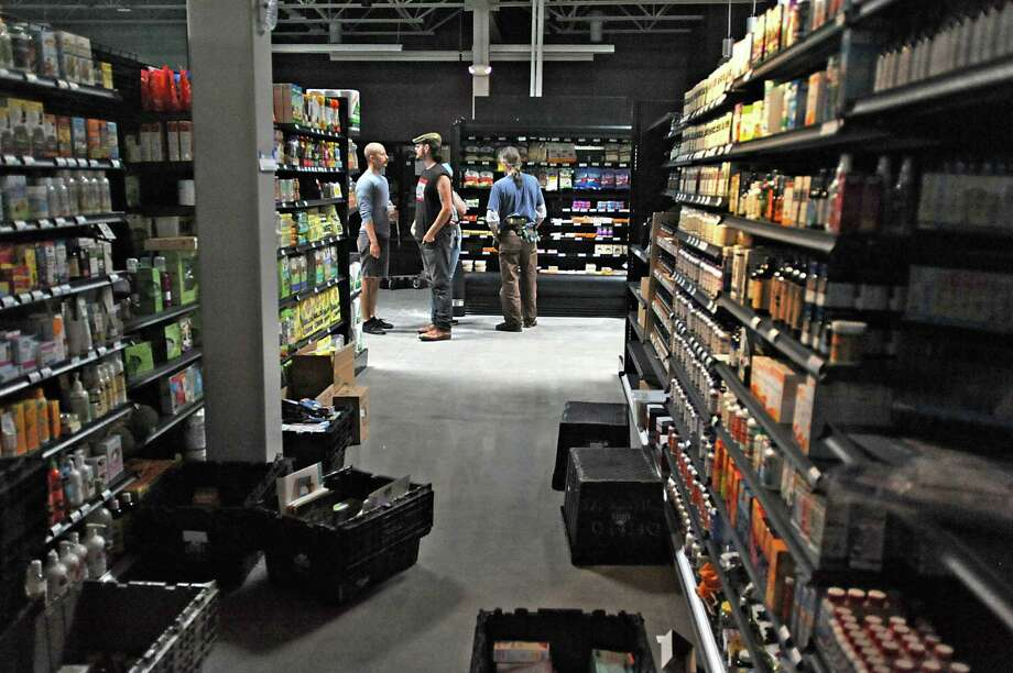 Workers fill the shelves at the new Honest Weight Food Co-op at 100 Watervliet Ave. on Monday, June 17, 2013 in Albany, N.Y. The soft opening is Wednesday. (Lori Van Buren / Times Union) Photo: Lori Van Buren / 10022837A