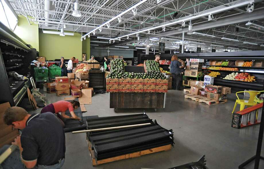 Workers are busy setting up the produce department at the new Honest Weight Food Co-op at 100 Watervliet Ave. on Monday, June 17, 2013 in Albany, N.Y. The soft opening is Wednesday. (Lori Van Buren / Times Union) Photo: Lori Van Buren / 10022837A