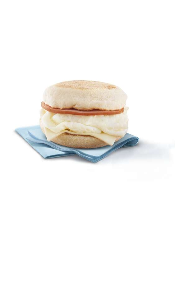 McDonald's Egg White Delight McMuffin Total calories: 250. Fat grams: 7. Carbs: 32. Sodium: 800. Dietary fiber: 5. Protein: 18 grams. Manufacturer's suggested retail price: $2.70 (your price and mileage may vary).  What Hoffman says: Egg White Delights are so low in calories and fat grams that big eaters might consider ordering two sandwiches and holding the hash browns. You'll actually save a few fat grams. Photo: Courtesy Photo