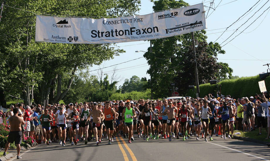 The first wave in a sea of 4,500 runners takes off from the starting line of last year's Stratton Faxon Fairfield Half Marathon. In the wake of April's Boston Marathon bombings, security has been beefed up for Sunday's race and for a 5K run on Saturday. Photo: B.K. Angeletti, File Photo / Connecticut Post