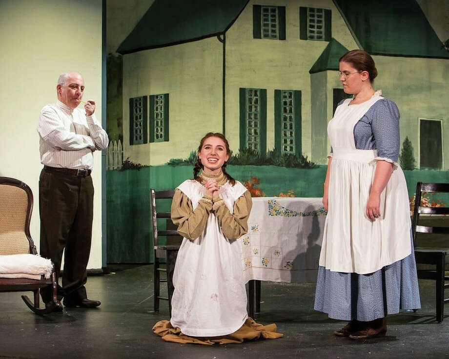 "Left to right in a scene from ""Anne of Green Gables"" are Jeff Rossman as Matthew Cuthbert, Emma Nissenbaum as Anne Shirley, and Stacy-Lee Frome as Marilla Cuthbert.The show is on stage at The Sherman Playhouse through July 27. Photo: Contributed Photo"