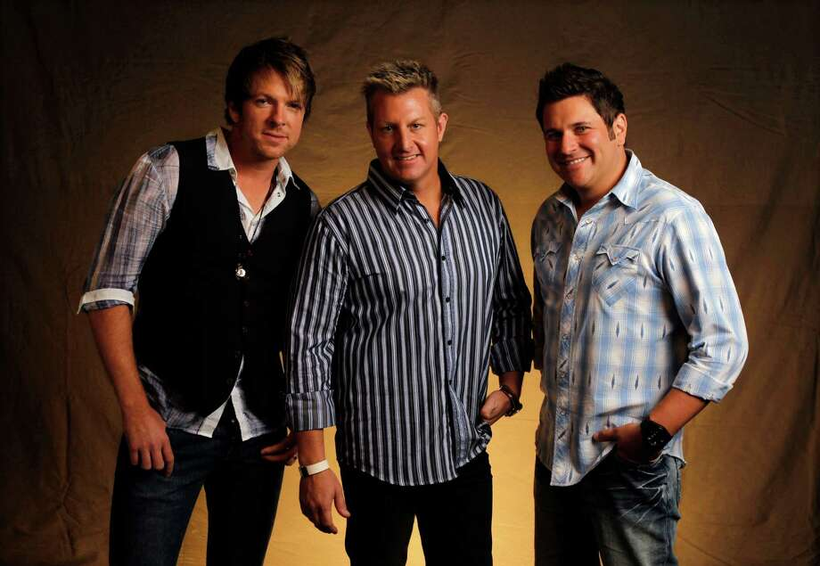 This Sept. 29, 2010 photo shows Joe Don Rooney, left, Gary Levox, and Jay DeMarcus, right, of Rascal Flatts in Nashville, Tenn.  After a decade as country music's top-selling group with nearly 20 million albums sold and one of its most popular touring acts, Rascal Flatts is starting the next decade as veterans on top, and in transition.   (AP Photo/Mark Humphrey) Photo: Mark Humphrey