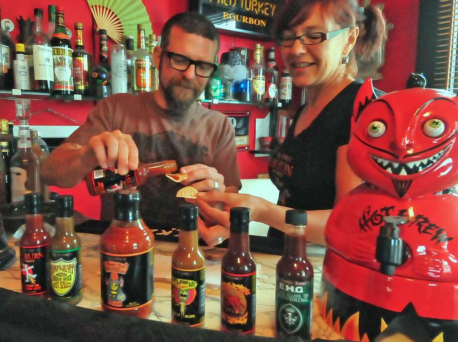 Heights residents Trevi  and Becky Biles are savoring the popularity of their line of Big Daddy Hot Sauces. Photo: Â Tony Bullard 2013, Freelance Photographer / © Tony Bullard & the Houston Chronicle