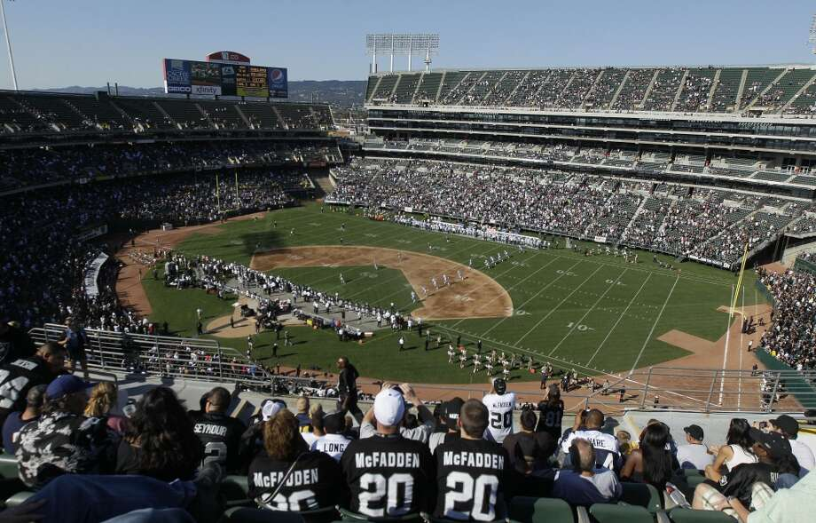 Fans at O.co Coliseum watch an NFL preseason football game between the Oakland Raiders and the Dallas Cowboys in Oakland, Calif., Monday, Aug. 13, 2012.
