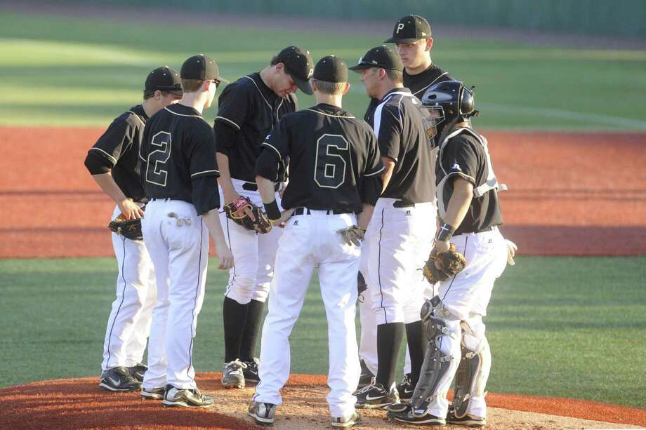 Vidor pitcher Trae Hester, center, has a meeting on the mound with teammates and  head coach Kyle Green after Crosby scored three runs during the third inning of  their playoff matchup  on Wednesday at Lamar's Vincent-Beck Stadium. 