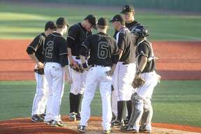 Vidor pitcher Trae Hester, center, has a meeting on the mound with teammates and  head coach Kyle Green after Crosby scored three runs during the third inning of  their playoff matchup  on Wednesday at Lamar's Vincent-Beck Stadium.  May 5, 2010. Valentino Mauricio/The Enterprise