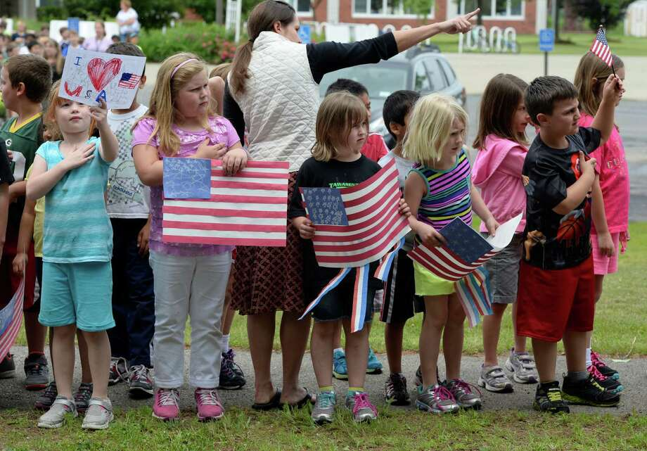 Students from the Pine Bush Elementary School line up outside their school June 18, 2013, to show their respect for Lt. Col. Todd Clark as his funeral procession passes the school in Guilderland, N.Y.        (Skip Dickstein/Times Union) Photo: SKIP DICKSTEIN / 10022863A