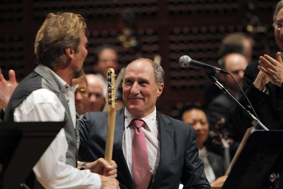 "Guitarist and vocalist Kenny Loggins' (left) contribution to a concert honoring former San Francisco Symphony President John Goldman (right) included the hits ""House at Pooh Corner"" and ""Danny's Song."" Photo: Carlos Avila Gonzalez, The Chronicle"