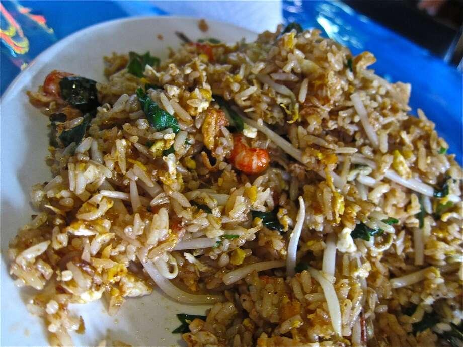 "Crawfish fried rice ""Thai Style,"" with Thai basil and jalapeños, at Wild Cajun."