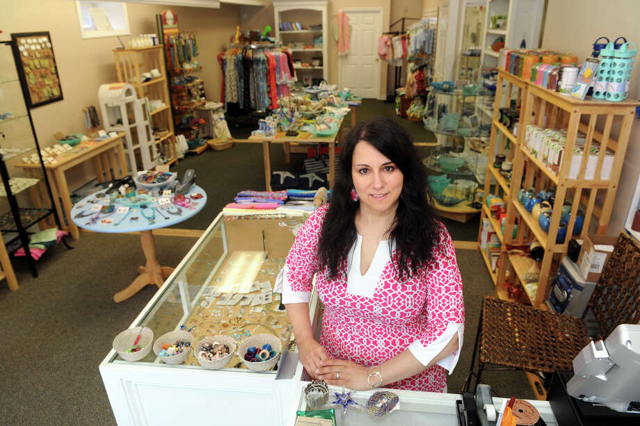 Tina Giammarco is the owner of Most Naturally, a shop at 26 Broad Street, in Milford, Conn., June 18th, 2013. Photo: Ned Gerard / Connecticut Post