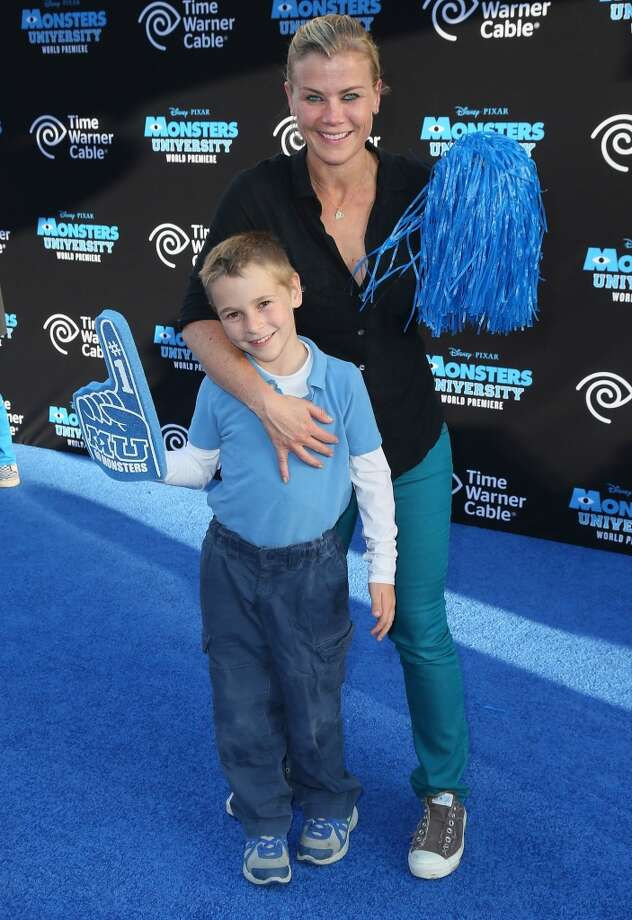 "HOLLYWOOD, CA - JUNE 17:  Actress Alison Sweeney (R) and son Ben Edward Sanov attend the premiere of Disney Pixar's ""Monsters University"" at the El Capitan Theatre on June 17, 2013 in Hollywood, California.  (Photo by David Livingston/Getty Images)"