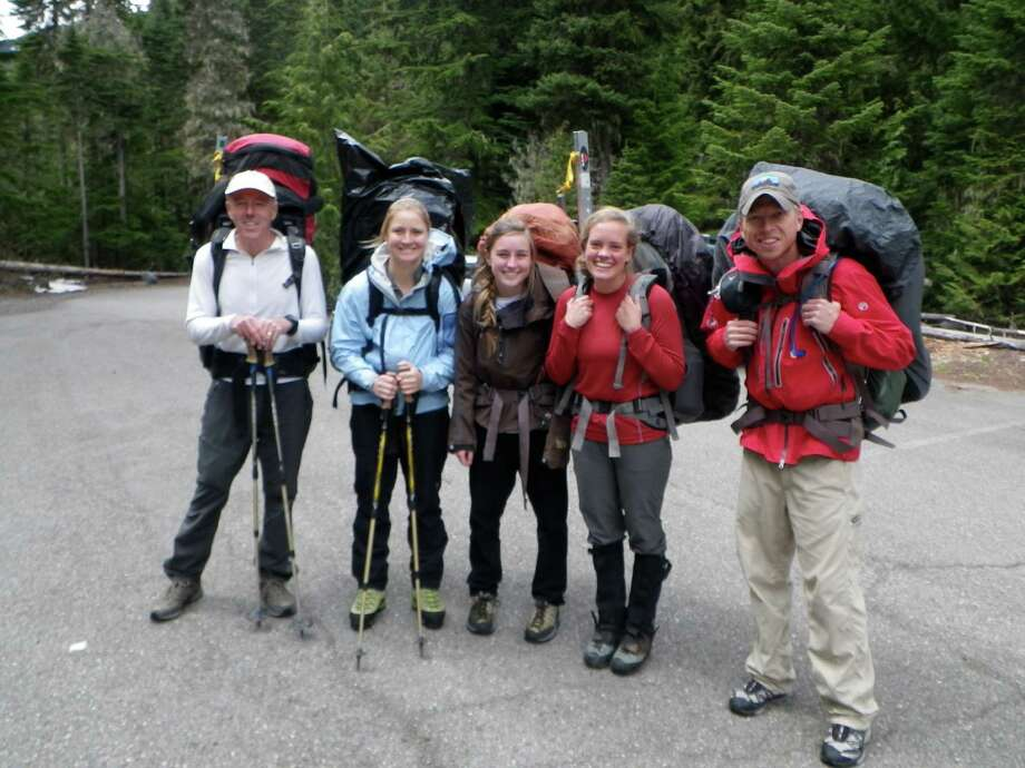 June 2012 (Courtesy of Stacy Wren) Five climbers from Texas prepare to leave a Mount Rainier National Park parking lot and begin their climb of the mountain....From left to right:...Stuart Smith...Claire Kultgen...Noelle Smith...Stacey Wren...Ross Van Dyke. Kultgen ended up not trying to reach the summit, as she wasn't feeling well, and watched through binoculars from a base camp as her teammates fell. She was the first to notify park rangers of the accident, and set in motion a rescue that involved the Army Reserve from nearby Joint Base Lewis McChord Photo: Courtesy Stacy Wren / handout