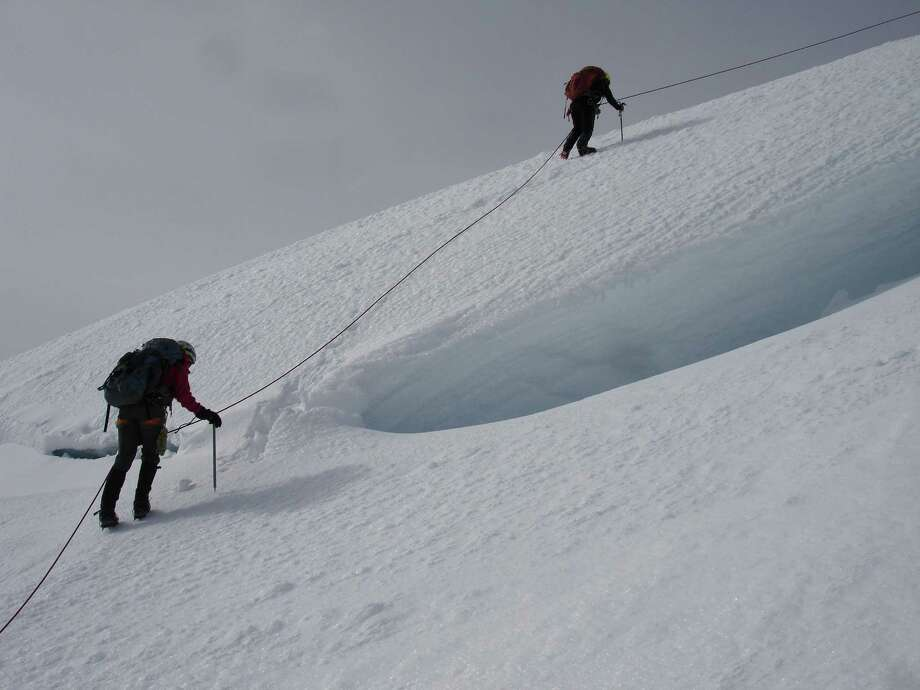 Two Texas  climbers just about to the summit of Mount Rainier. Stacy Wren is on the left and Noelle Smith is on the right. 