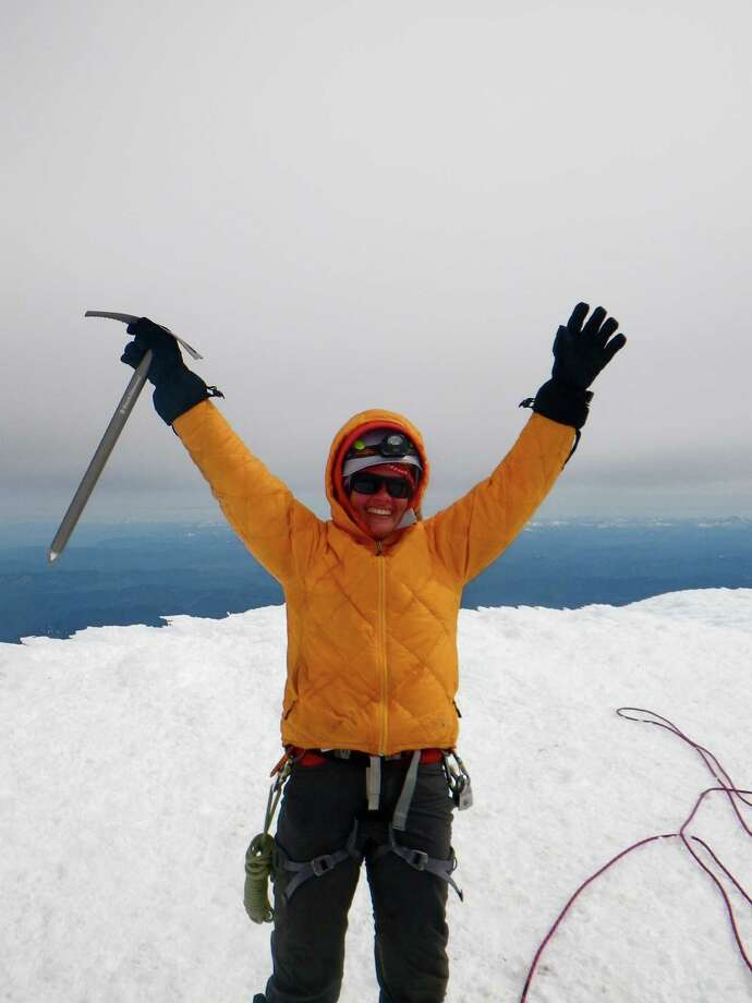 June 21, 2012 Courtesy of Stacy Wren Stacy Wren atop the 14,410 foot tall Mount Rainier, in Washington state, on June 21, 2012. Less than an hour after stepping off the summit, she and three other Texans tumbled down a side of the mountain in a tragedy that also claimed the life of Park Ranger Nick Hall.  Wren was 22 and fresh out of Baylor University at the time of the accident. She is now an intern at Outward Bound School, in Colorado.  Earlier this month she made her first snow climb since Rainier, and was again carrying her ice axe, which was lost during the accident but later mailed to her by a climber who found it in a crevasse. Photo: Courtesy Stacy Wren / handout