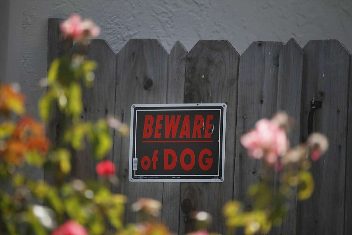 A sign on a fence at the home where a six-year-old boy was mauled on Monday by a relative's dog warns people to Beware of Dog on Tuesday, June 18, 2013 in Union City, Calif.