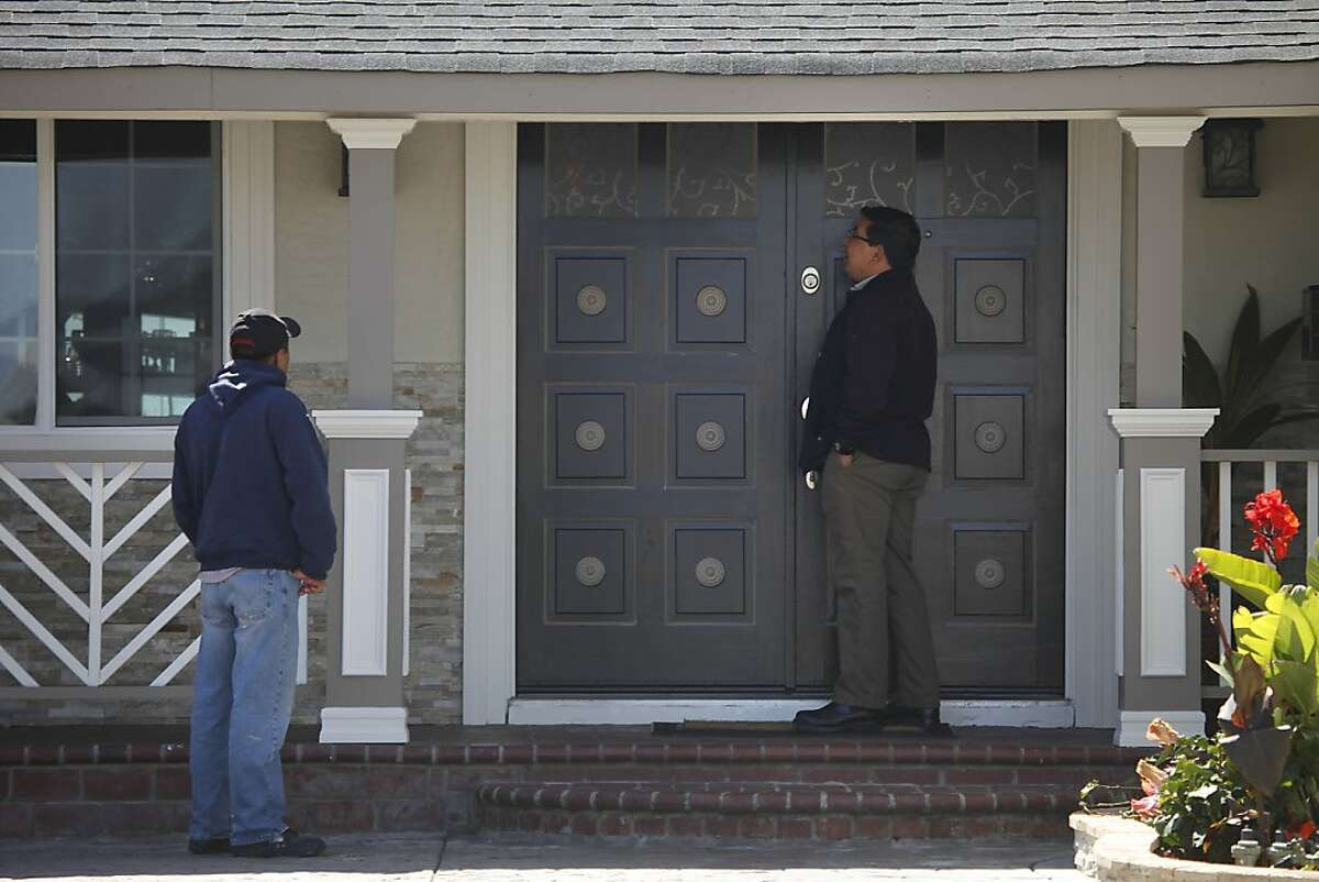 Two people arrive at the home where a six-year-old boy was mauled on Monday by a relative's dog on Tuesday, June 18, 2013 in Union City, Calif.