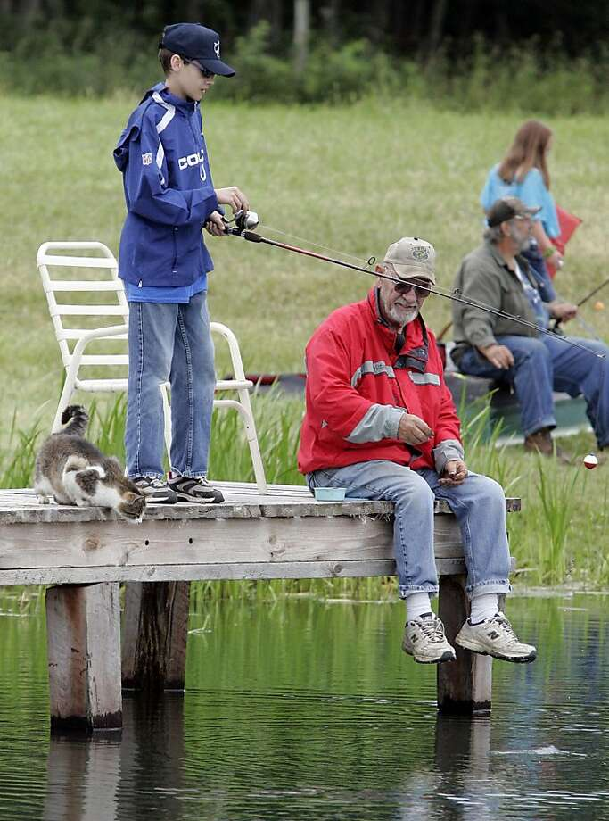 Interested bystander:John Chesnut hopes his visually impaired grandson, Noah Scherf, hooks a big one during the   Fishing For Life event in Westville, Ind., and he's not the only one. Photo: Bob Wellinski, Associated Press
