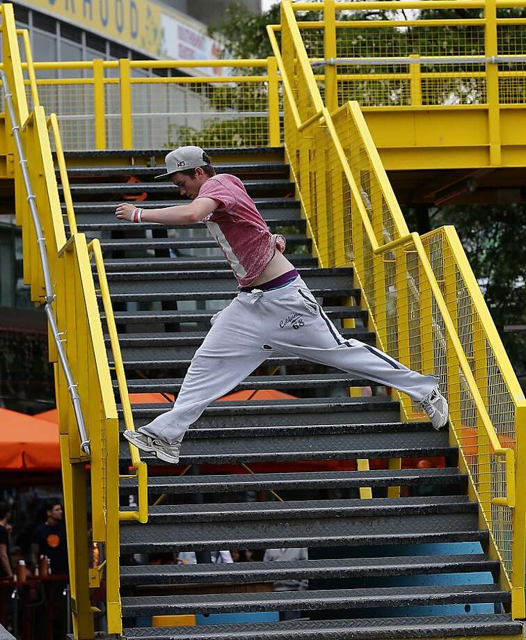 Parkour practitionerRob never takes the stairs at Southbank in London - he prefers the   railings. Photo: Frank Augstein, Associated Press