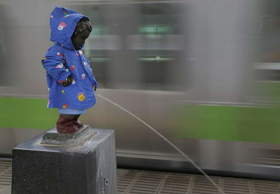 Little squirt:The rainy season has begun in Japan, so someone put a raincoat on the Peeing Boy, a local landmark in a Tokyo railway station. Photo: Itsuo Inouye, Associated Press