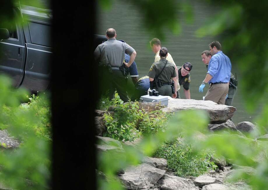 Police tend to a body found in Lake Lillinonah in Bridgewater, Conn. on Tuesday, June 18, 2013.  The body has not yet been identified.  Last week, New Milford photographer Eric Langlois went missing from Lover's Leap State Park in New Milford, near where the body was found today. Photo: Tyler Sizemore / The News-Times