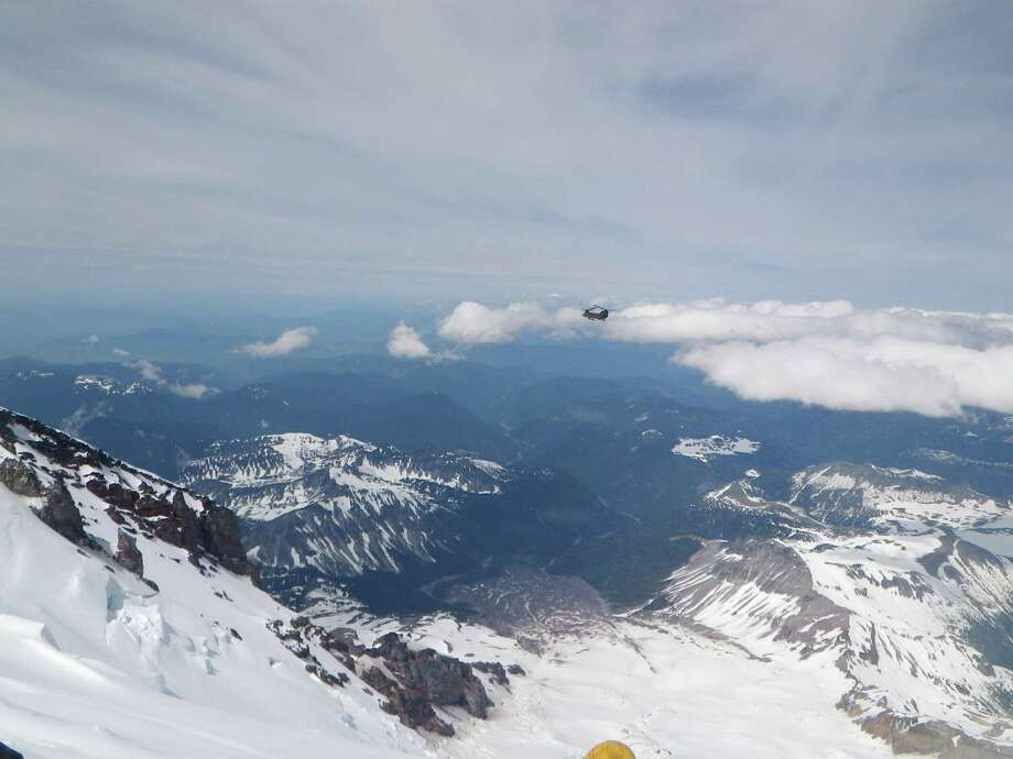Views of Army Chinook flying in to rescue injured Texas climbers on Mount Rainier June 21, 2012 Photo: Stacy Wren / handout