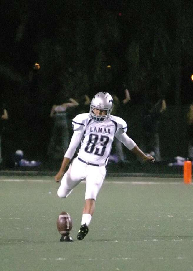 Lamar Consolidated alumnus Juan Ramirez drilled three field goals, including a 51-yarder, in the Texas squad's 22-14 victory over Louisiana in the 11th Bayou Bowl in Baytown. Photo: Eddy Matchette, Freelance / Freelance