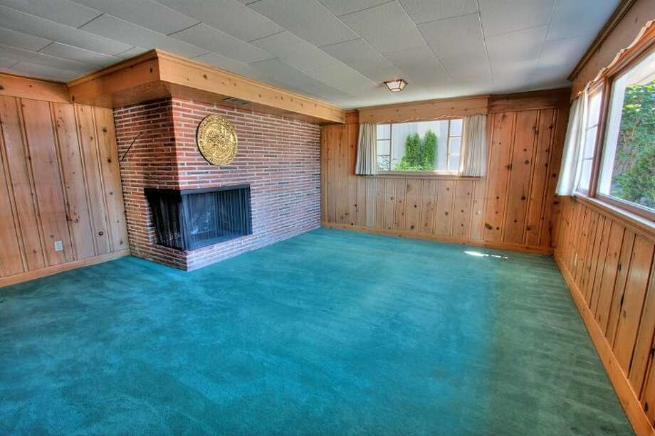 Basement rec room with fireplace of 2804 N.W. 93rd St., in North Beach. The 3,150-square-foot house, built in 1947, has four bedrooms, three bathrooms, picture windows, a conservatory, a den, a patio with a fountain and a two-car garage on a 7,650-square-foot lot. It's listed for $789,000. Photo: Courtesy Bonnie Ellsworth, Windermere Real Estate