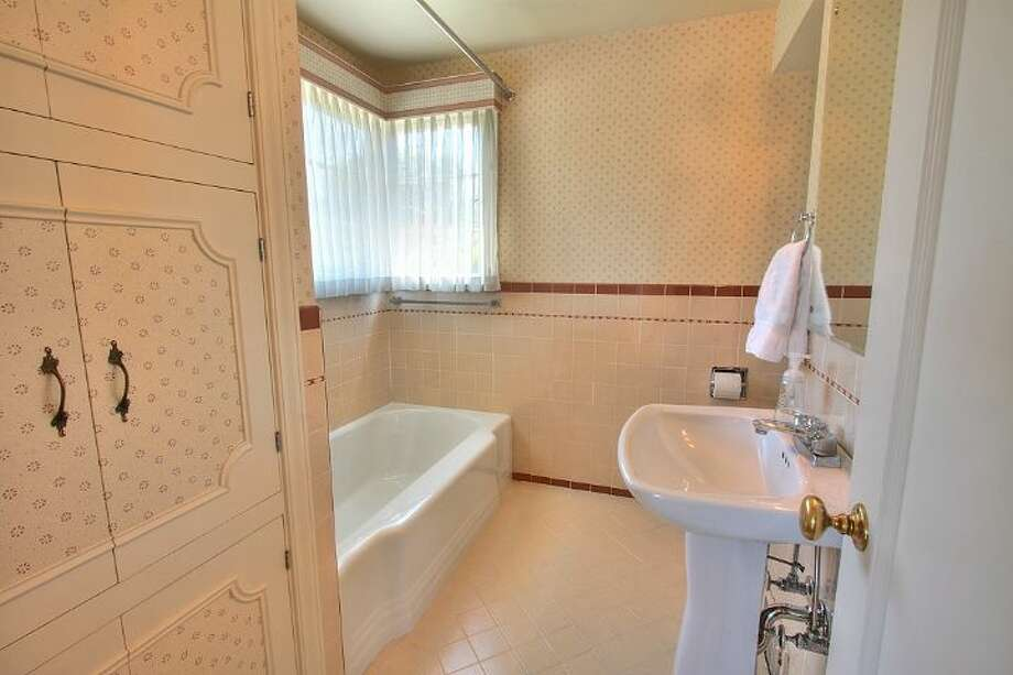 Bathroom of 2804 N.W. 93rd St., in North Beach. The 3,150-square-foot house, built in 1947, has four bedrooms, three bathrooms, picture windows, a conservatory, a den, a rec room with a fireplace, a patio with a fountain and a two-car garage on a 7,650-square-foot lot. It's listed for $789,000. Photo: Courtesy Bonnie Ellsworth, Windermere Real Estate