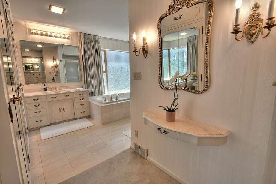 Master bathroom of 2804 N.W. 93rd St., in North Beach. The 3,150-square-foot house, built in 1947, has four bedrooms, three bathrooms, picture windows, a conservatory, a den, a rec room with a fireplace, a patio with a fountain and a two-car garage on a 7,650-square-foot lot. It's listed for $789,000. Photo: Courtesy Bonnie Ellsworth, Windermere Real Estate