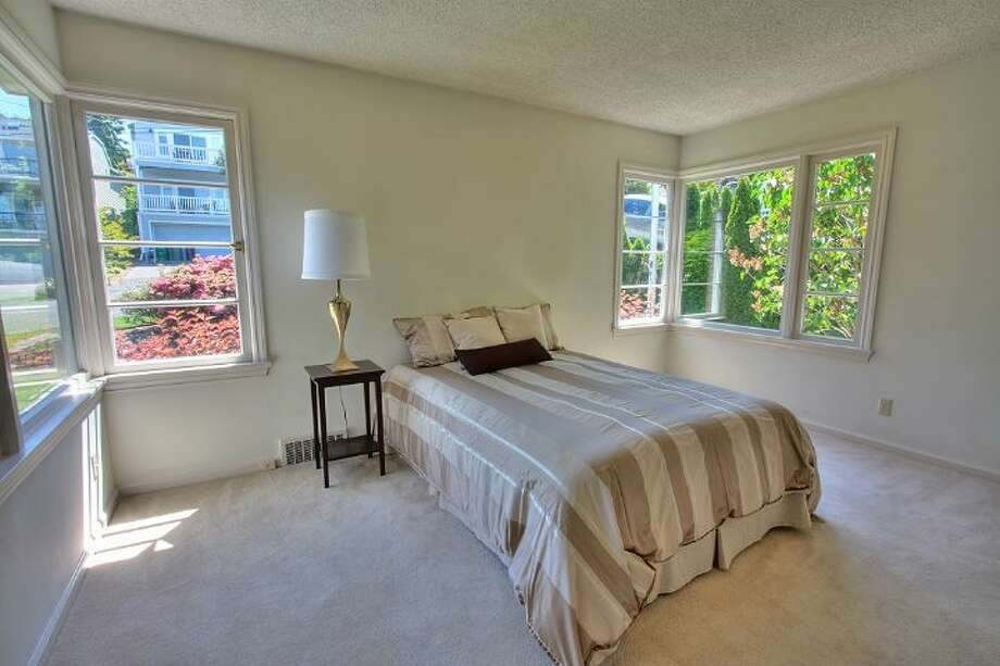 Master bedroom of 2804 N.W. 93rd St., in North Beach. The 3,150-square-foot house, built in 1947, has four bedrooms, three bathrooms, picture windows, a conservatory, a den, a rec room with a fireplace, a patio with a fountain and a two-car garage on a 7,650-square-foot lot. It's listed for $789,000. Photo: Courtesy Bonnie Ellsworth, Windermere Real Estate