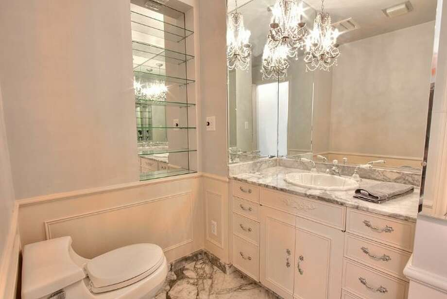 Powder room of 2804 N.W. 93rd St., in North Beach. The 3,150-square-foot house, built in 1947, has four bedrooms, three bathrooms, picture windows, a conservatory, a den, a rec room with a fireplace, a patio with a fountain and a two-car garage on a 7,650-square-foot lot. It's listed for $789,000. Photo: Courtesy Bonnie Ellsworth, Windermere Real Estate