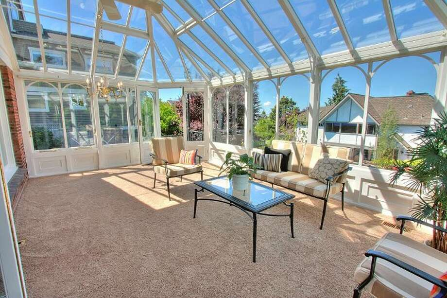 Conservatory of 2804 N.W. 93rd St., in North Beach. The 3,150-square-foot house, built in 1947, has four bedrooms, three bathrooms, picture windows, a conservatory, a den, a rec room with a fireplace, a patio with a fountain and a two-car garage on a 7,650-square-foot lot. It's listed for $789,000. Photo: Courtesy Bonnie Ellsworth, Windermere Real Estate
