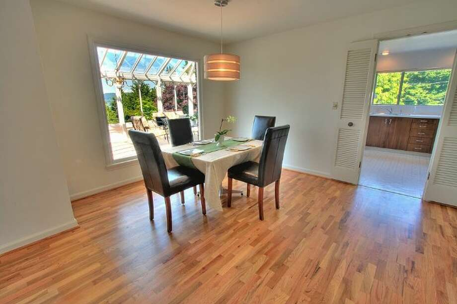Dining room of 2804 N.W. 93rd St., in North Beach. The 3,150-square-foot house, built in 1947, has four bedrooms, three bathrooms, picture windows, a conservatory, a den, a rec room with a fireplace, a patio with a fountain and a two-car garage on a 7,650-square-foot lot. It's listed for $789,000. Photo: Courtesy Bonnie Ellsworth, Windermere Real Estate