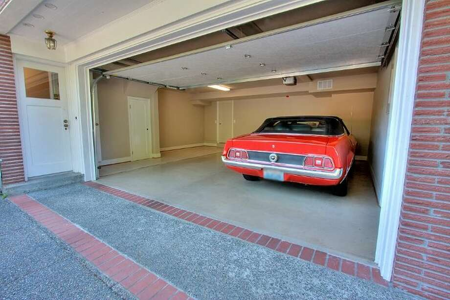 Two-car garage of 2804 N.W. 93rd St., in North Beach. The 3,150-square-foot house, built in 1947, has four bedrooms, three bathrooms, picture windows, a conservatory, a den, a rec room with a fireplace and a patio with a fountain on a 7,650-square-foot lot. It's listed for $789,000. Photo: Courtesy Bonnie Ellsworth, Windermere Real Estate