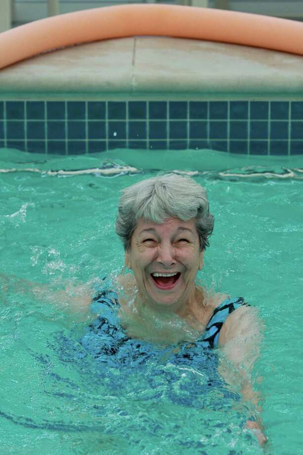 Audrey Richardson enjoys an exercise class for Eagle's Trace residents in the community pool. Photo: Gary Fountain / Copyright 2013 Gary Fountain
