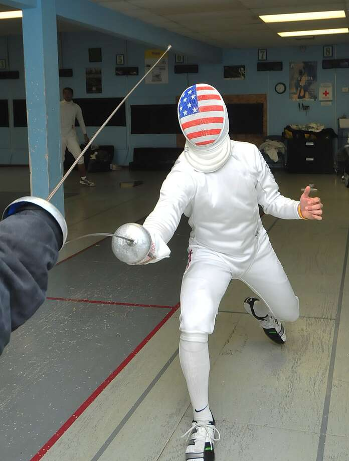"World Champion fencer Ariel Simmons, 16, practices with instructor Sergey Danilov  at Alliance Fencing Academy. Winning a championship in épée fencing is ""just a cool experience and I can't stop taking it in,"" Simmons says. Photo: Â Tony Bullard 2013, Freelance Photographer / © Tony Bullard & the Houston Chronicle"