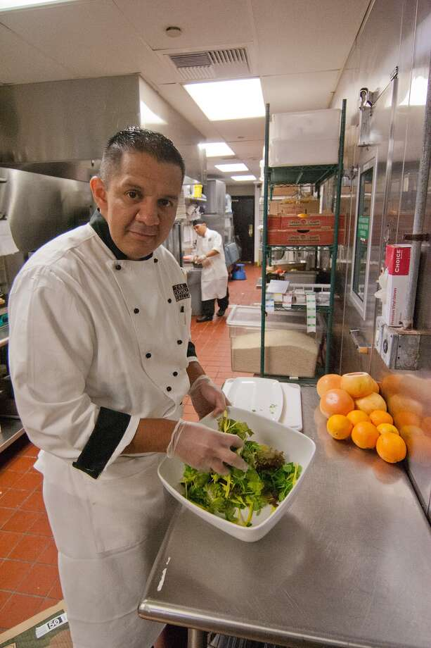 Ricardo Vargas prepares food at The Capital Grille. Photo: R. Clayton McKee, Freelance / © R. Clayton McKee