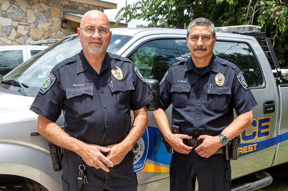 Grey Forest Police Chief C.E. (Bubba ) Rutledge, left, and incoming police chief David Bejar June 13. Rutledge is retiring on June 30. Photo: Marvin Pfeiffer / Northwest Weekly